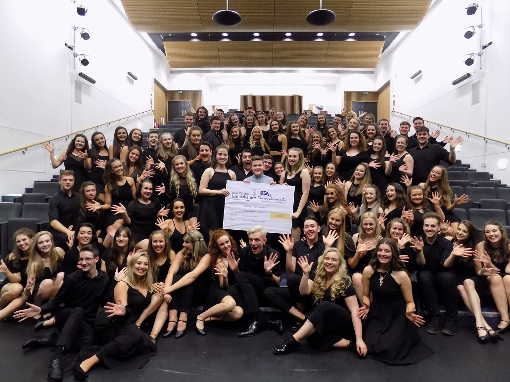 HNC and HND Musical Theatre students present cheque to Toby Etheridge.JPG