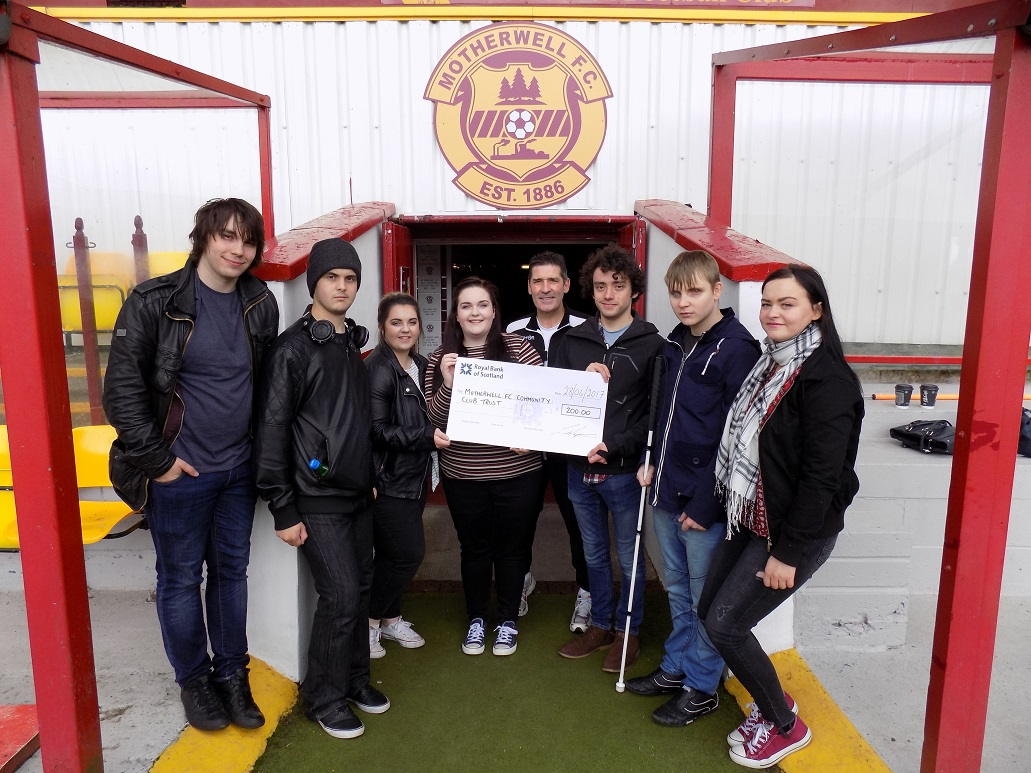 HND Music students present cheque to Jim Chapman.JPG