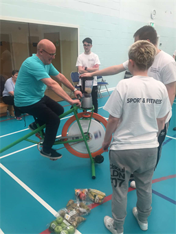 HND Sports Coaching students and guest having a go on the smoothie bike.