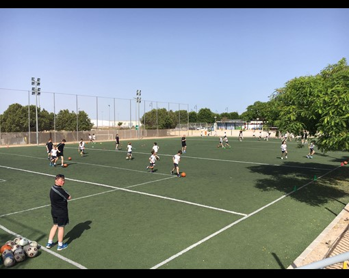 NQ Football Performance students coaching youths in Murcia