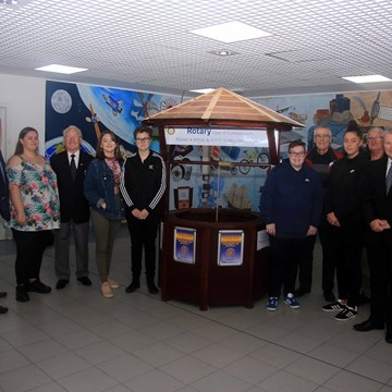 NCL staff and students hand over wishing well to Rotary Club of Cumbernauld.jpg